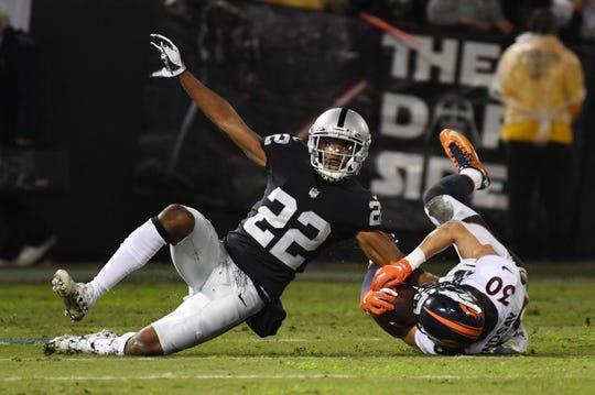 Raiders cornerback Rashaan Melvin tackles Broncos running back Phillip Lindsay on Dec 24, 2018.