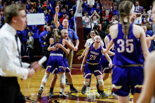 Adrian Lenawee Christian players and coaches rush the court to celebrate their 48-46 win over St. Ignace during the second half of MHSAA girls Division 4 final at Van Noord Arena in Grand Rapids, Saturday, March 23, 2019.