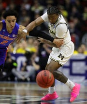 Michigan's Zavier Simpson steals the ball from Florida's Andrew Nembhard in the first half.