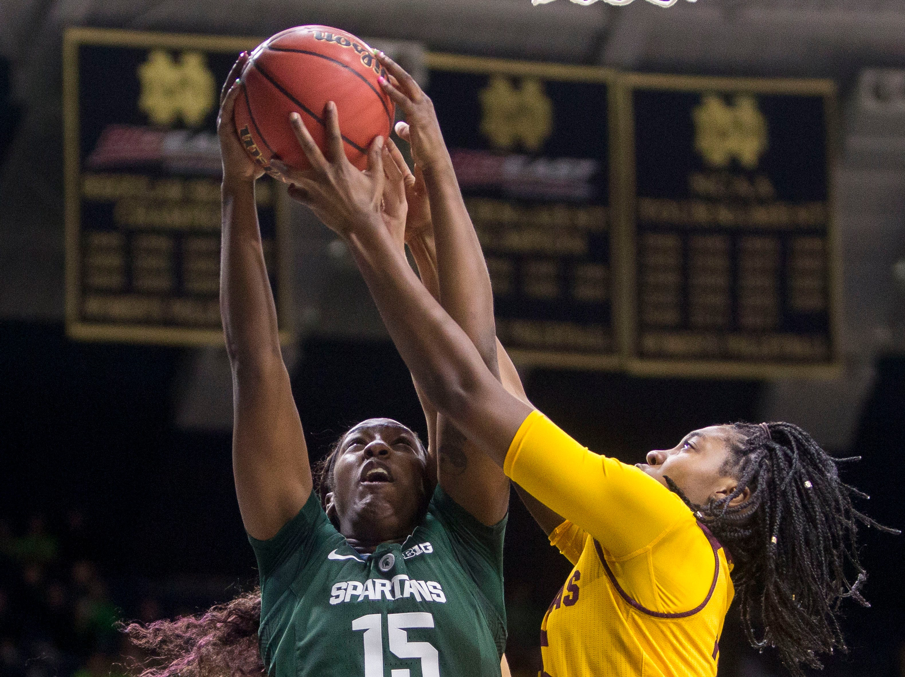 Michigan State's Victoria Gaines (15) competes for a rebound with Central Michigan's Jahari Smith, right, during a first-round game in the NCAA women's college basketball tournament in South Bend, Ind., Saturday, March 23, 2019.