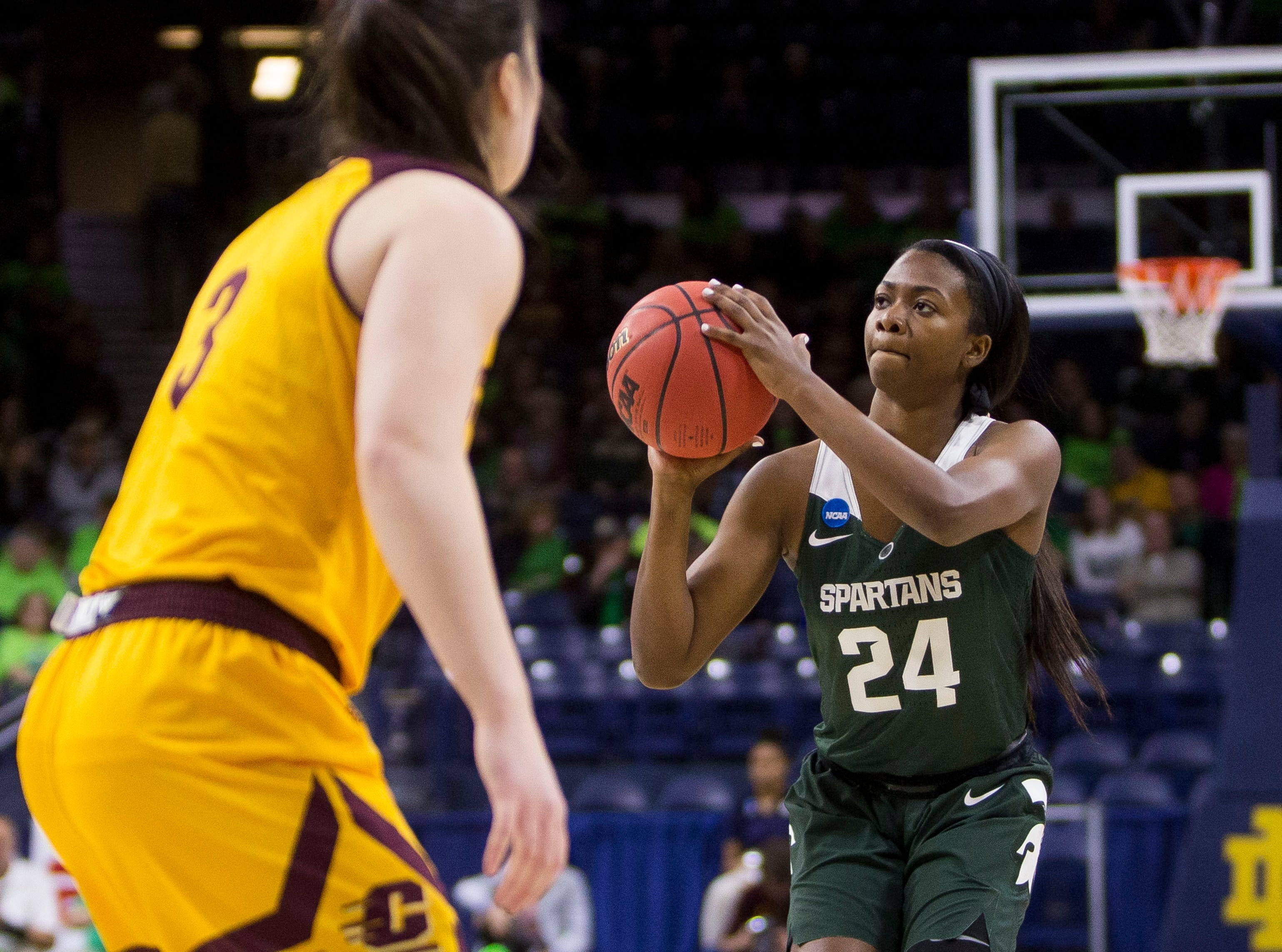 Michigan State's Nia Clouden (24) goes up for a 3-pointer in front of Central Michigan's Presley Hudson (3) during a first-round game in the NCAA women's college basketball tournament in South Bend, Ind., Saturday, March 23, 2019.