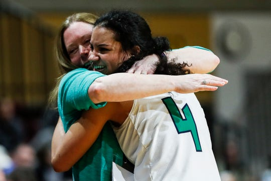 Saginaw Heritage head coach Vonnie DeLong hugs guard Moira Joiner (4) in the last seconds of the second half of MHSAA girls Division 1 final against Southfield Arts & Technology at Van Noord Arena in Grand Rapids, Saturday, March 23, 2019.
