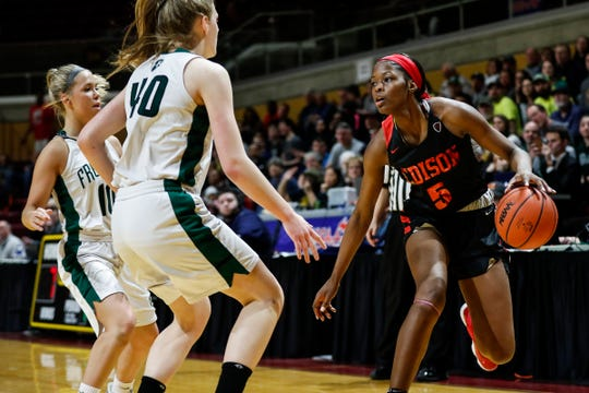 Detroit Edison guard Rickea Jackson (5) dribbles against Freeland guard Lily Beyer (10) and forward Kadyn Blanchard (40) during the first half of MHSAA girls Division 2 final at Van Noord Arena in Grand Rapids, Saturday, March 23, 2019.