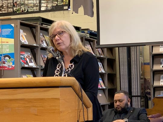 City Manager Kathy Angerer speaks at a community meeting about the impact of a GM Detroit/Hamtramck Assembly Plant closure held at the Hamtramck Public Library, Saturday, March 23, 2019.