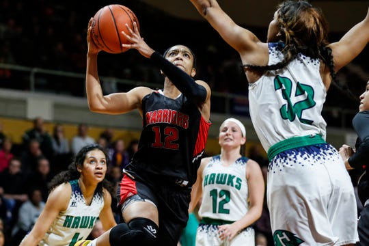Southfield Arts & Technology guard Cheyenne McEvans (12) makes a layup against Saginaw Heritage forward Shine Strickland-Gills (32) during the first half of MHSAA girls Division 1 final at Van Noord Arena in Grand Rapids, Saturday, March 23, 2019.