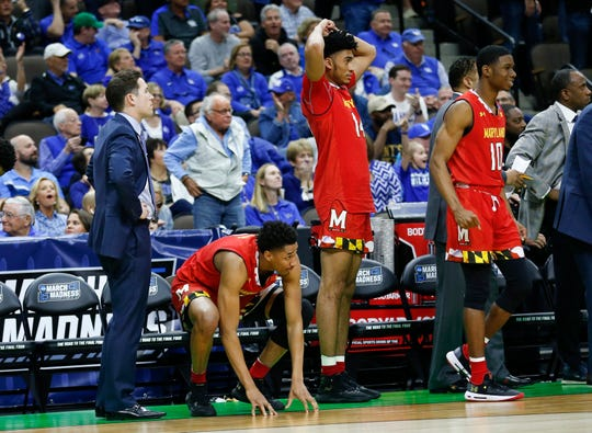 Maryland players, from left, Aaron Wiggins, Ricky Lindo Jr. and Darryl Morsell react as LSU makes a winning shot in the closing second.