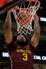 Jordan Murphy scored 18 and pulled down six rebounds in Minnesota's win over Louisville.