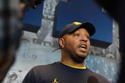 """""""Literally, he gave me the keys ... to the car,"""" Michigan offensive coordinator Josh Gattis said about coach Jim Harbaugh handing him the keys to a rental car before going on recruiting trip."""