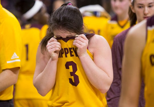 Central Michigan's Presley Hudson becomes emotional as she exits the court her final college basketball game. She finished as the all-time leading scorer in program history.