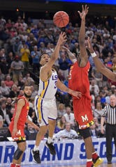 LSU guard Tremont Waters makes the winning shot as Maryland's Jalen Smith defends.