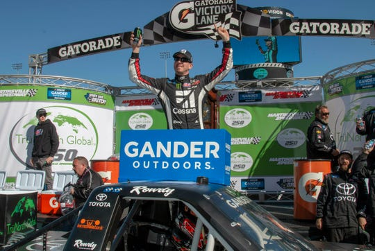 Kyle Busch celebrates career win 201 following the NASCAR Gander Outdoors Truck Series race Saturday at Martinsville Speedway in Martinsville, Va.