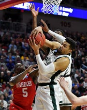 Michigan State's Kenny Goins grabs a round against Bradley. An injury limited the forward to seven minutes in the last game against Minnesota.