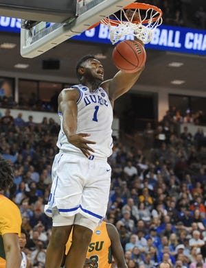 Duke's Zion Williamson dunks against North Dakota State during a first-round game in the NCAA men's college basketball tournament in Columbia, S.C. Friday, March 22, 2019. (AP Photo/Richard Shiro)