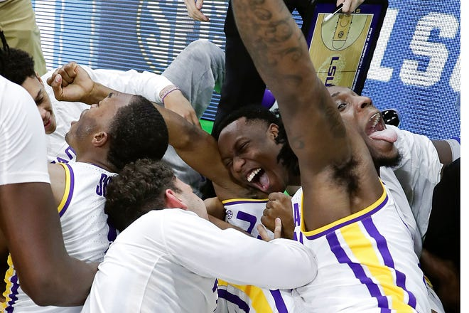 LSU players celebrate after defeating Maryland in the second round of the NCAA Tournament.