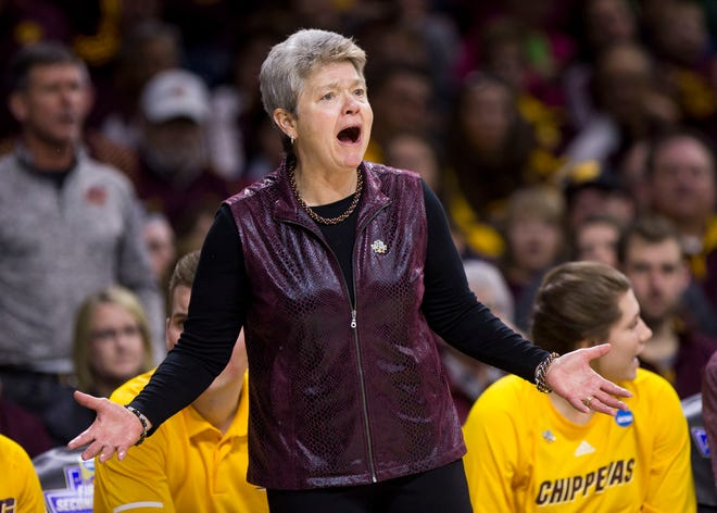 Central Michigan head coach Sue Guevara questions a call.