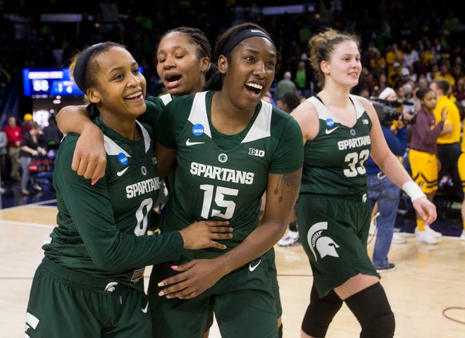 Michigan State's Shay Colley (0) and Victoria Gaines hug as they walk off the court following their 88-87 win over Central Michigan in the women's NCAA Tournament on Saturday, March 23, 2019, in South Bend, Ind.