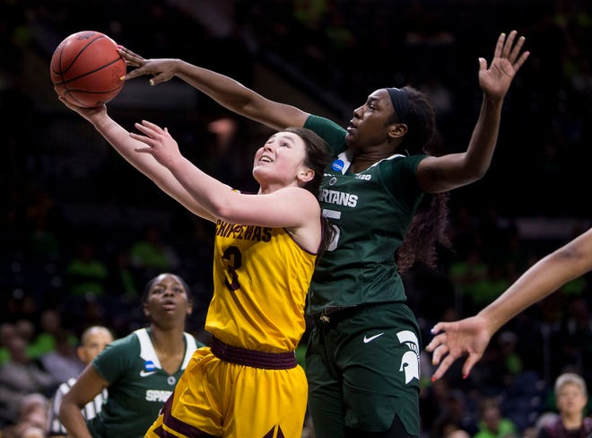 Michigan State's Victoria Gaines, right, blocks a shot by Central Michigan's Presley Hudson.