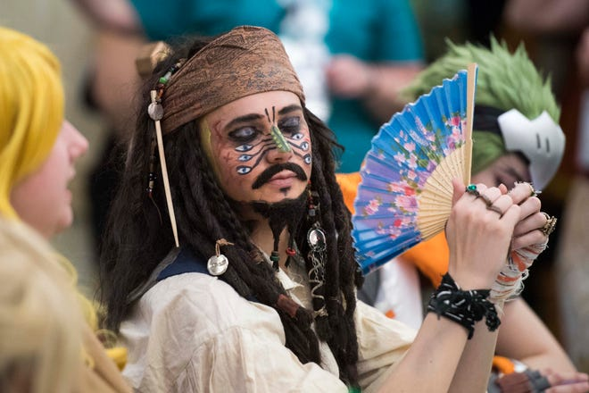 Judge Bret Collins dressed as Cannibal Jack Sparrow fans himself while waiting for the Cosplay Contest to start during EvilleCon 2019 Saturday, March 23, 2019.