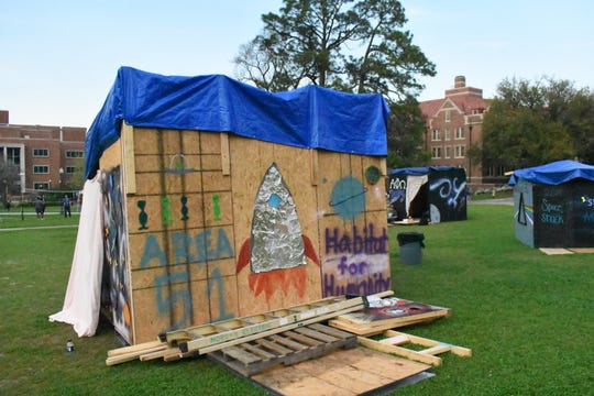 "Student organizations built wooden shacks and ""lived"" in them for three nights and four days to raise awareness and money for families in substandard housing."