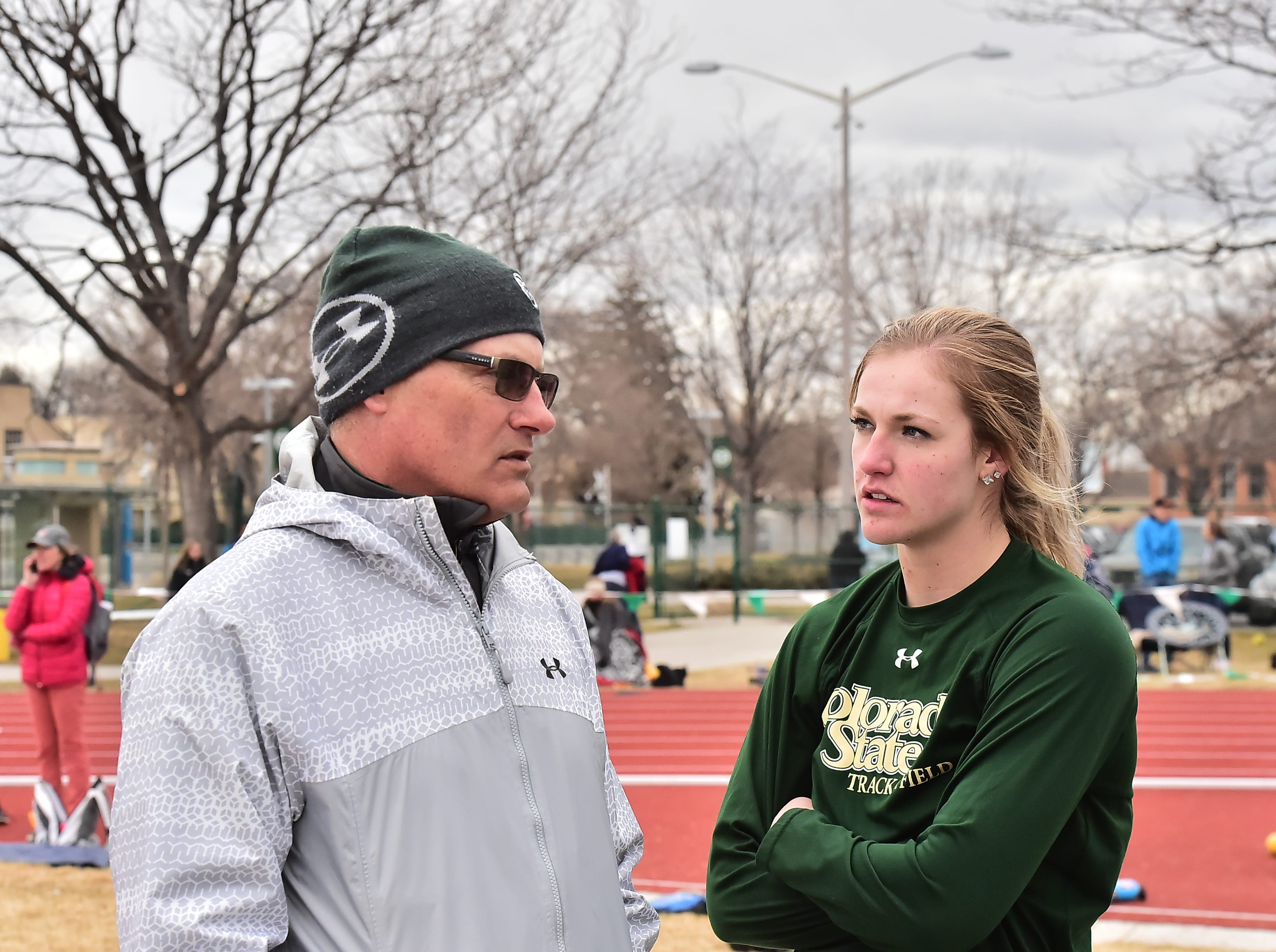 CSU coach Brian Bedard talks to women's shot put winner Tarynn Sieg during the Fum McGraw Open on Saturday, March 23, at Colorado State University's Jack Christiansen Track.