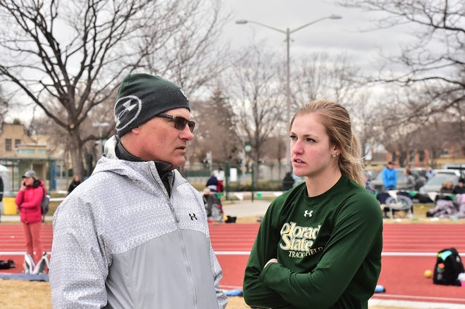 CSU track and field coach Brian Bedard talks to shot put winner Tarynn Sieg during a home meet March 23, 2019. Sieg, winner of the NCAA West Preliminary in the shot put, will compete for an NCAA Outdoor Championship in the event Thursday in Austin, Texas.