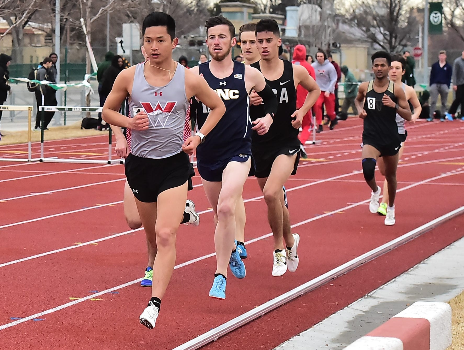 Western Colorado's Henry Briggs, a former Fort Collins High School athlete, leads runners through the early stages in the second heat of the men's 1,500-meter run Saturday, March 23, 2019, at CSU's Fum McGraw Open at Jack Christiansen Track.