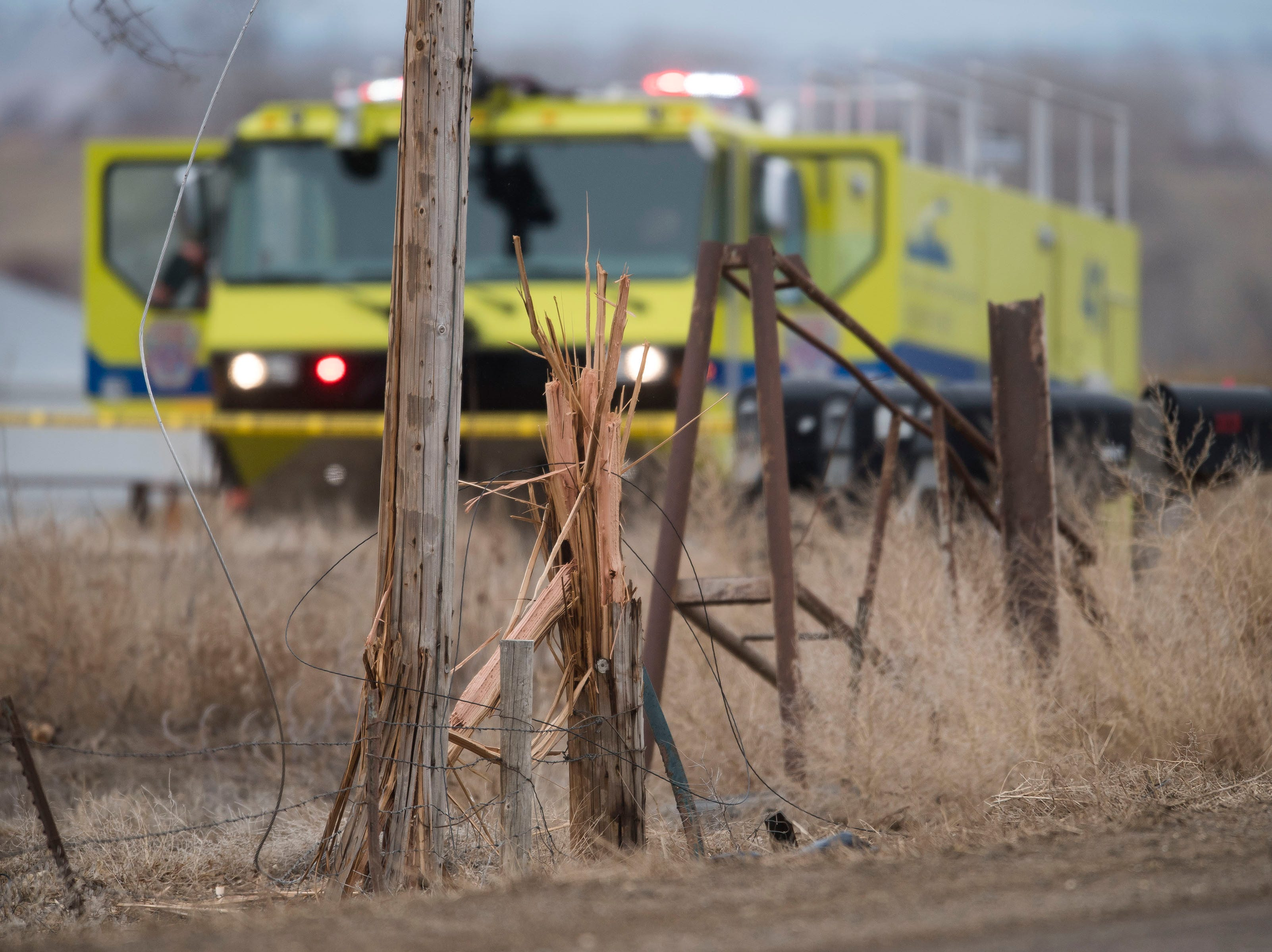 A power pole sits upright where it was sheared off Saturday, March 23, 2019 as a single-engine plane crashed west of the intersection of East County Road 30 and Boyd Lake Avenue in Fort Collins, Colo. Three people on the plane were hurt.