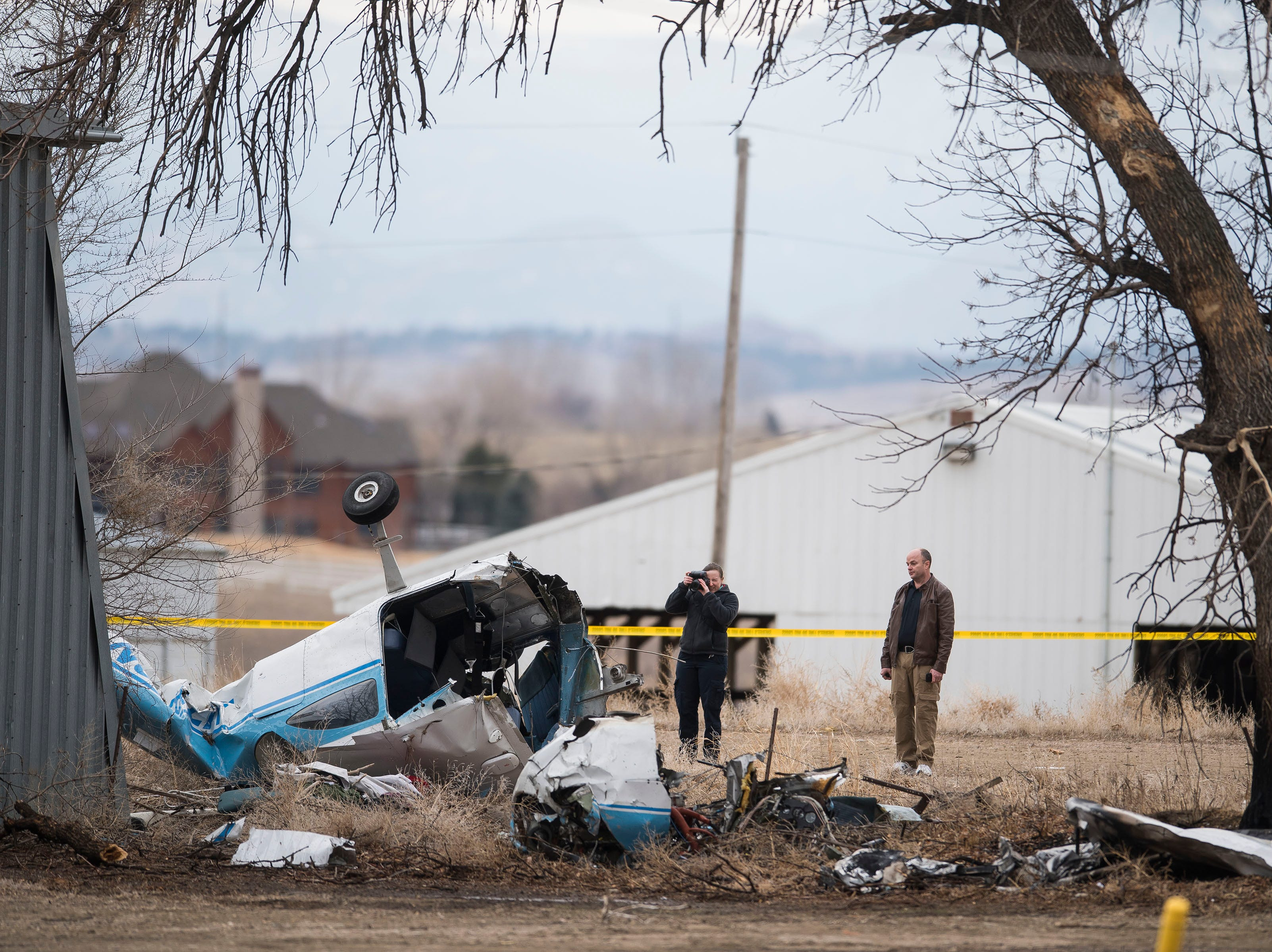 Sheriff 's department investigators document the scene of a small plane crash that injured three people on board Saturday, March 23, 2019. The crash occurred just west of the Northern Colorado Regional Airport.