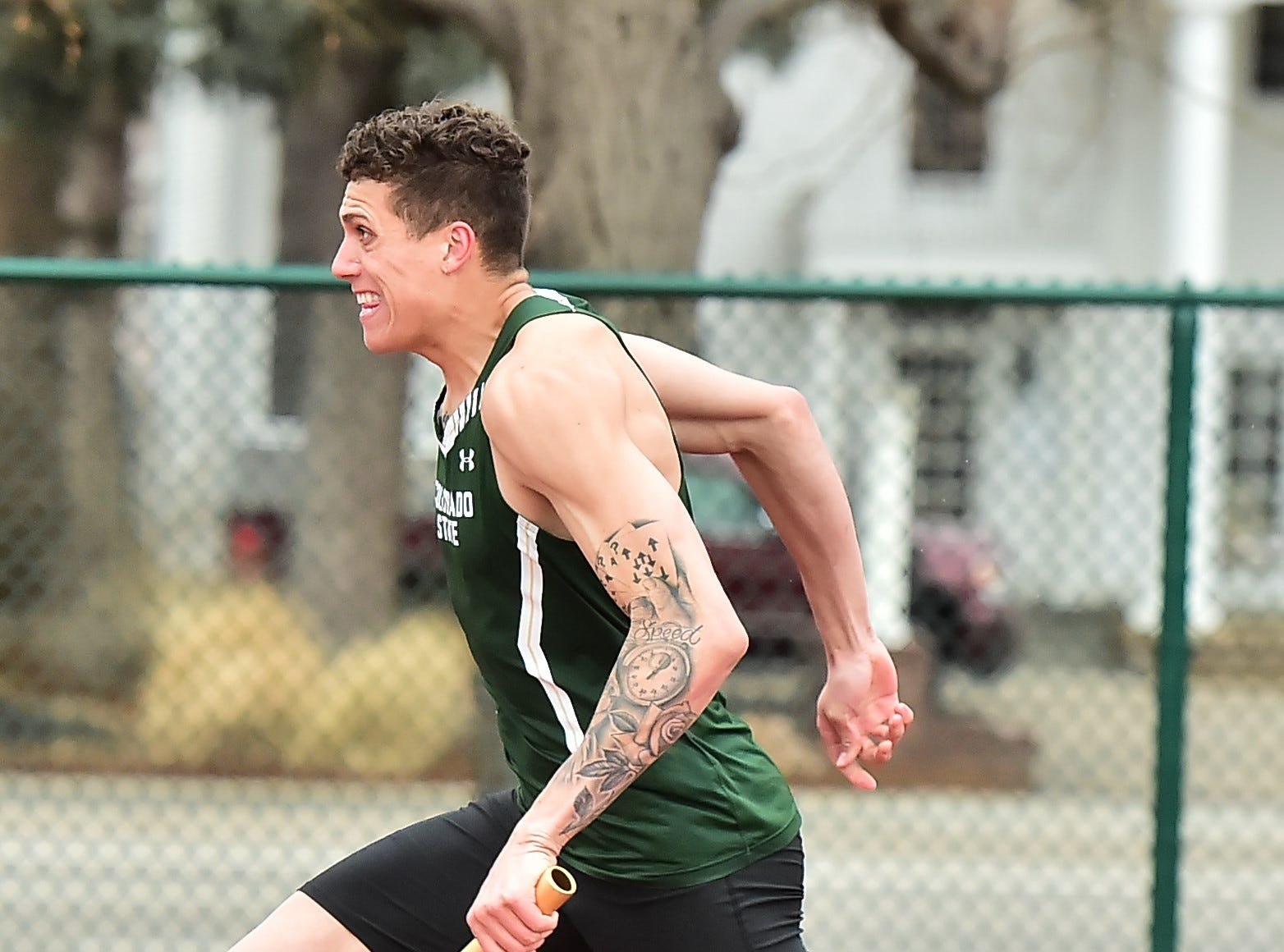 CSU's Caleb Hardy runs the second leg in the 4x100-meter relay on Saturday, March 23, 2019, in the Fum McGraw Open at Colorado State University's Jack Christiansen Track.