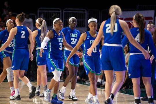 FGCU players gather after losing their game against the University of Miami during the first round of the NCAA Division I Women's Basketball Tournament Friday at Watsco Center in Coral Gables.