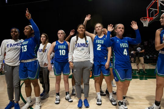 The FGCU women's basketball team thanks fans after losing to the University of Miami during the first round of the NCAA Tournament on Friday at Watsco Center in Coral Gables,