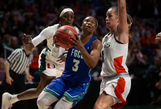 Florida Gulf Coast University's Keri Jewett-Giles attempts a basket against the University of Miami's Laura Cornelius during the first round of the NCAA Division I Women's Basketball championship game, Friday, March 22, 2019 at Watsco Center in Coral Gables, Florida.