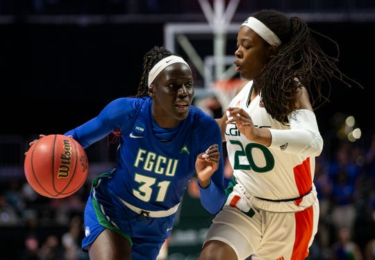 Florida Gulf Coast University's Nasrin Ulel drives on University of Miami's Kelsey Marshall during the first round of the NCAA Division I Women's Basketball Tournament Friday at Watsco Center in Coral Gables.
