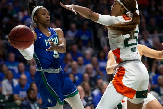 FGCU's Keri Jewett-Giles attempts to pass the ball against Miami's Khaila Prather during the first round of the NCAA Tournament on Friday at Watsco Center in Coral Gables. The Eagles lost, 69-62.
