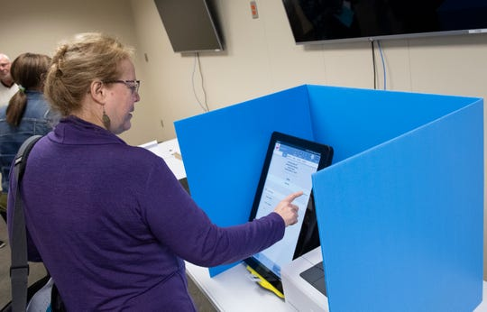 Suzy Hart, of Easley, uses a demo voting ballot at in the Greenville County Elections Office Saturday, March 23, 2019. The voting system by Dominion Voting will be used during the election Tuesday at First Church of God in Taylors.