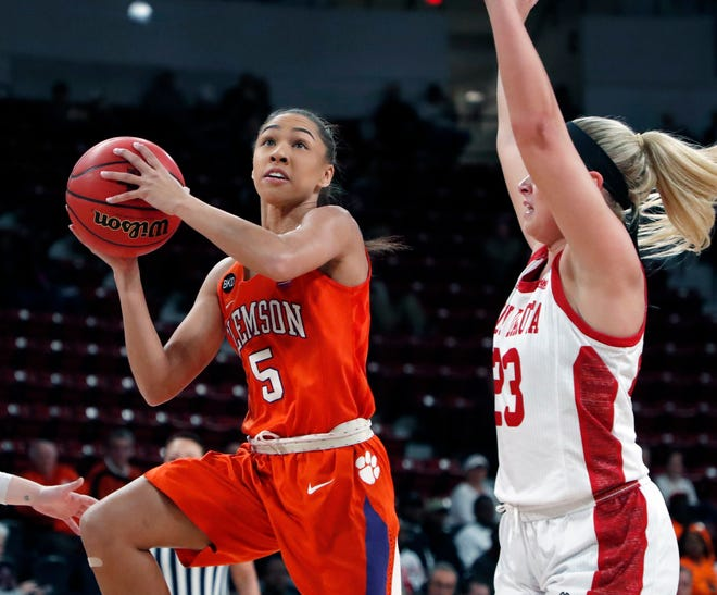 Clemson guard Danielle Edwards (5) attempts a layup while South Dakota guard Madison McKeever (23) defends during a first round women's college basketball game in the NCAA Tournament in Starkville, Miss., Friday.