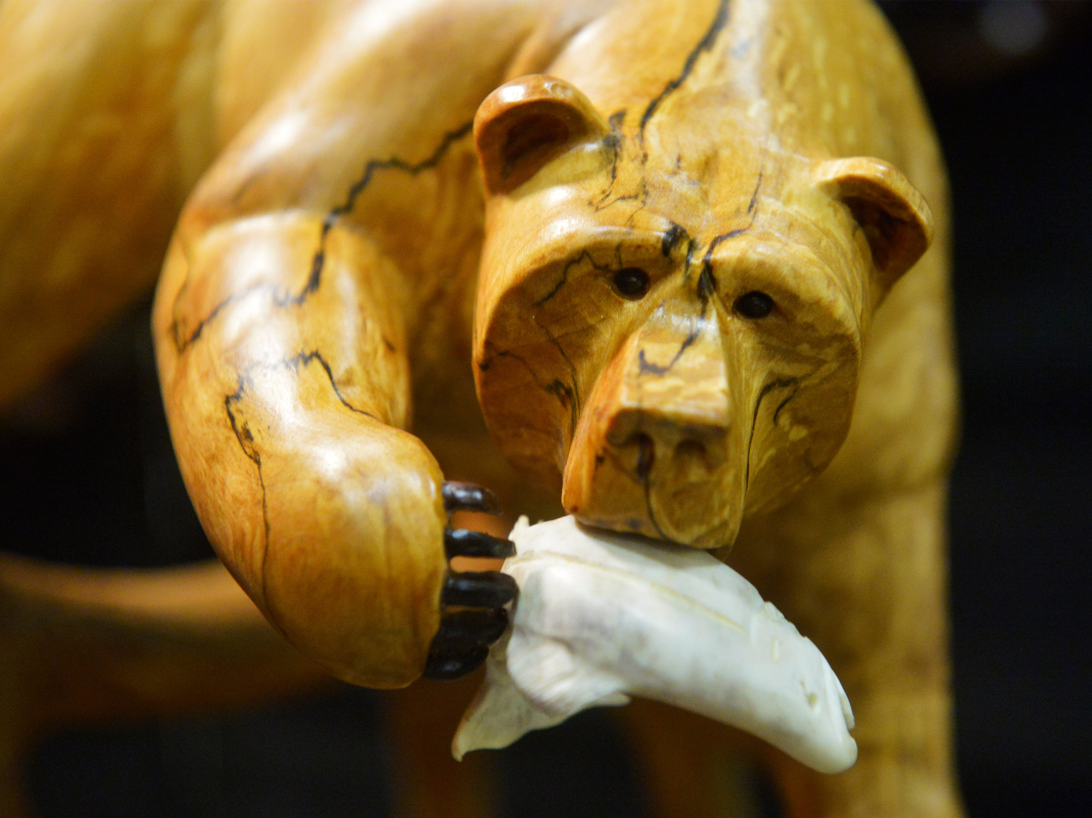 Stephen Fracul used spalding birch burl and white tail deer horn for this carving of a grizzly bear eating salmon on display at the Great Western Living and Design Show in the Four Seasons Arena on Friday.