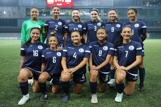 Guam's U15 Girls National Team ahead of its opening match against Singapore in the UEFA-FAS International U15 Girls Development Tournament in Singapore. Standing, from left: goalkeeper Gabrielle Moser, Isabella Clement, Ashley Larkin, Jordan Baden, Samantha Santos, and Mia Rose Borja. Kneeling, from left: Danni Jo Santos, Olivia Haddock, Anna Jones, Sarah Benavente, and Annika Almario.