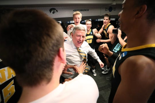 Iowa assistant coach Kirk Speraw is shown celebrating with the Hawkeye players following their Friday win against Cincinnati.