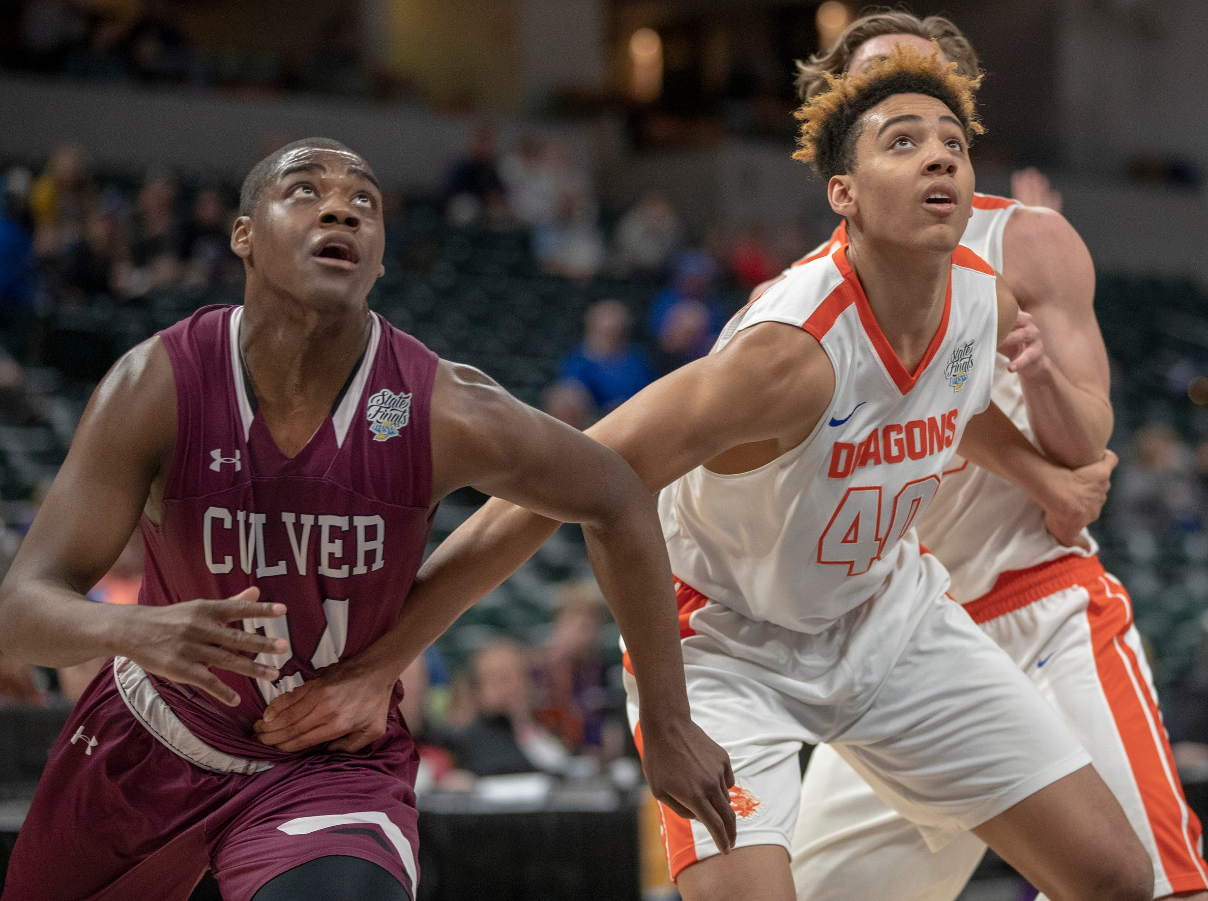 Deontae Craig (left), of Culver Academies and Trey Kaufman of Silver Creek Dragons look for a rebound in the Class 3S Boys Basketball State Final, Bankers Life Fieldhouse, Indianapolis, Saturday, March 23, 2019.