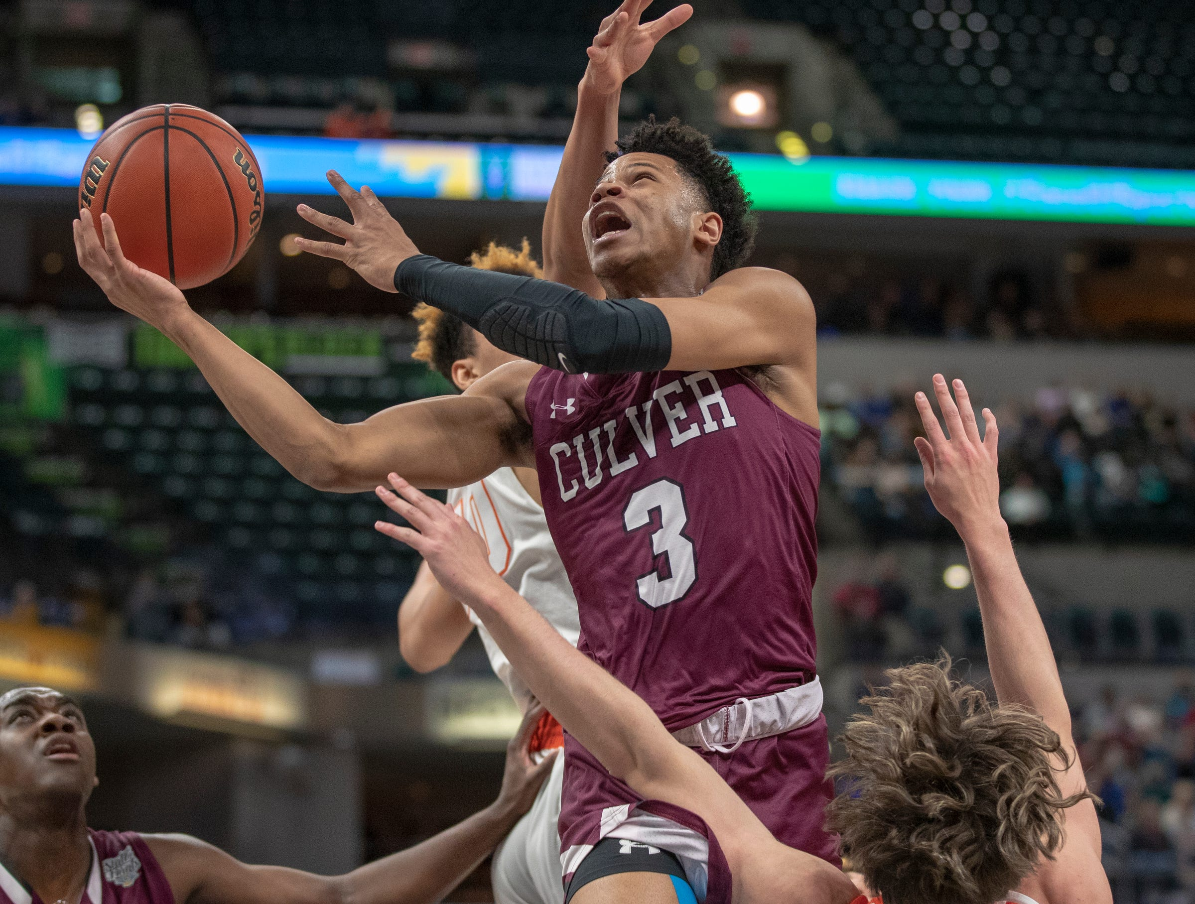 Ethan Brittain-Watts of Culver Academy, puts up a shot, Culver Academies vs. Silver Creek Dragons in the Class 3S Boys Basketball State Final, Bankers Life Fieldhouse, Indianapolis, Saturday, March 23, 2019.