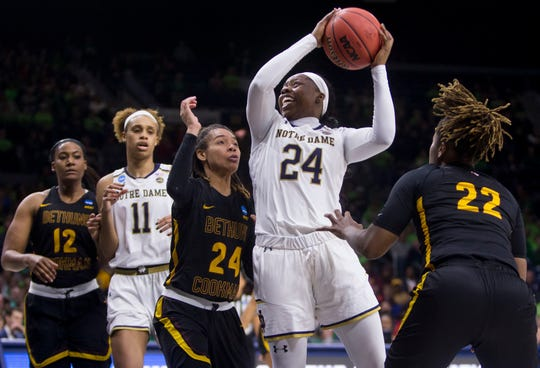 Notre Dame's Arike Ogunbowale (24) goes up for a shot between Bethune-Cookman's Angel Golden (24) and Tania White (22) during a first-round game in the NCAA women's college basketball tournament in South Bend, Indiana, Saturday, March 23, 2019.