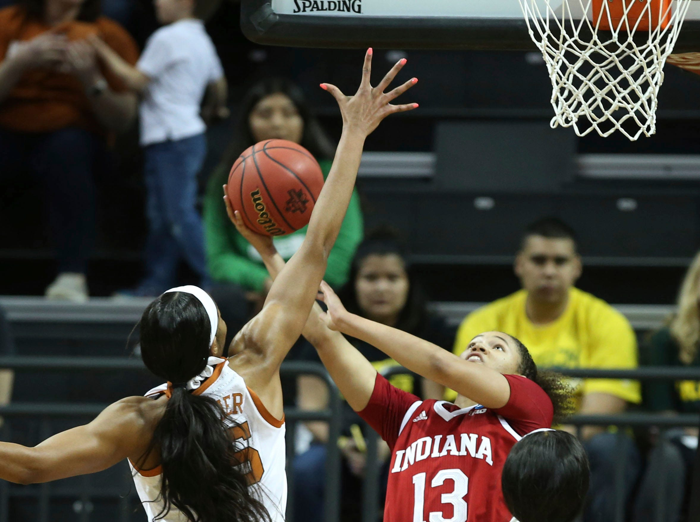 Texas Charli Collier, left, swats a shot by Indiana's Jaelynn Penn during the second quarter of a first-round game in the NCAA women's college basketball tournamentFriday, March 22, 2019, in Eugene, Ore.