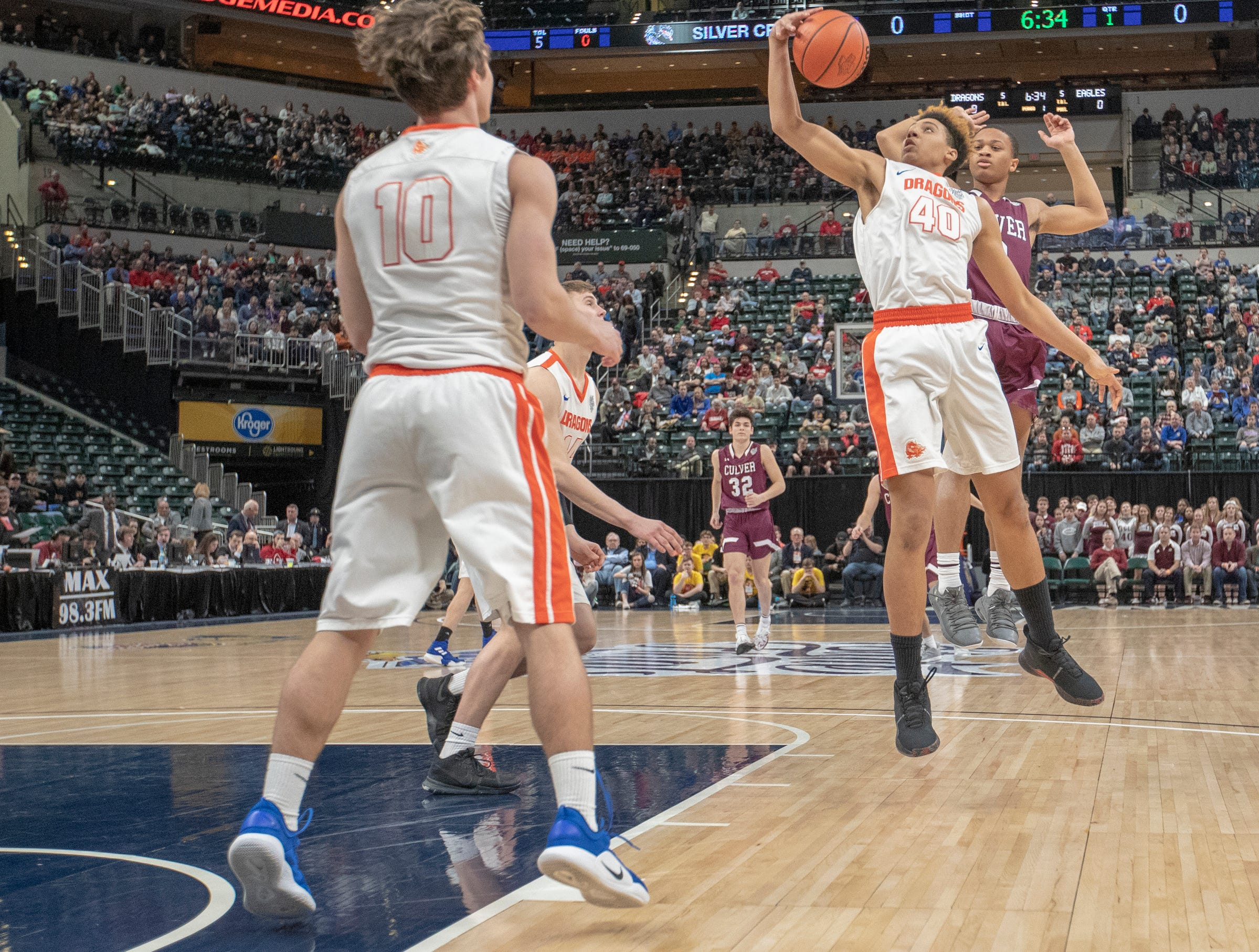 Trey Kaufman of Silver Creek High School pulls down a rebound during first half action, Culver Academies vs. Silver Creek Dragons in the Class 3S Boys Basketball State Final, Bankers Life Fieldhouse, Indianapolis, Saturday, March 23, 2019.
