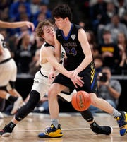 Barr-Reeve Vikings Isaac Wagler (12) knocks the ball away from Fort Wayne Blackhawk Christian Braves Zane Burke (24) in the first half of the IHSAA A Boys Basketball State Finals at Bankers Life Fieldhouse on Mar. 23, 2019.