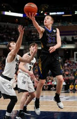 Blackhawk Christian's Frank Davidson (32) scores two of his 20 points against Barr-Reeve in the Class A final.