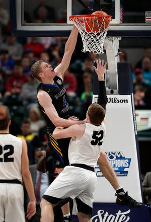 Fort Wayne Blackhawk Christian Braves Caleb Furst (3) slams down two points over Barr-Reeve Vikings Quentin Yoder (52) in the first half of the IHSAA A Boys Basketball State Finals at Bankers Life Fieldhouse on Mar. 23, 2019.