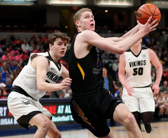 Blackhawk Christian Braves Caleb Furst (3) drives around Barr-Reeve Vikings Hagen Knepp (34) in the second half of the IHSAA A Boys Basketball State Finals at Bankers Life Fieldhouse on Mar. 23, 2019. The Fort Wayne Blackhawk Christian Braves defeated the Barr-Reeve Vikings  60-43.