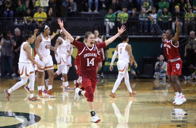 Indiana's Ali Patberg, center, starts the celebration with teammate Bendu Yeaney, right, after Indiana defeated Texas in an NCAA women's college basketball tournament game Friday, March 22, 2019, in Eugene, Ore.