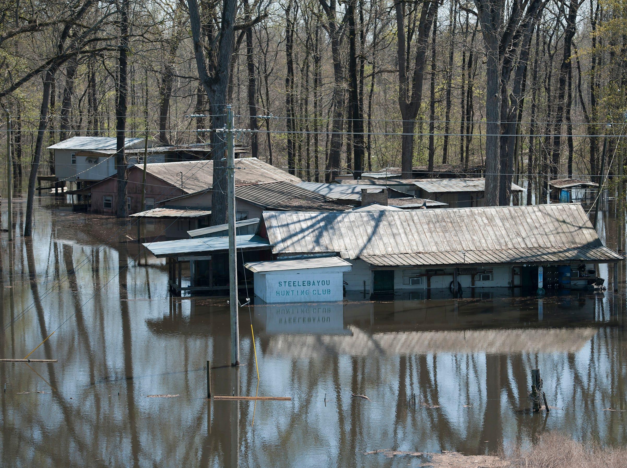 Backwater flooding surrounds Steele Bayou Hunting Club along MS 465 in Warren County.